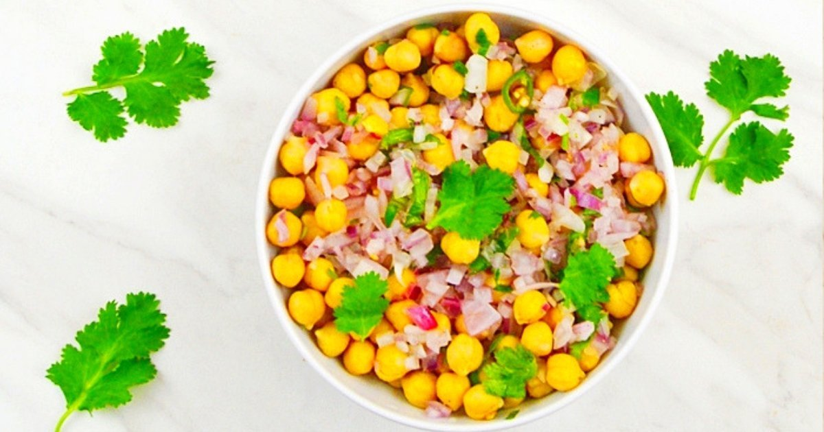simple chickpea salad in a white bowl