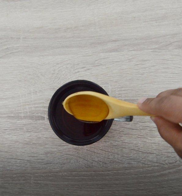 mixing honey to hibiscus tea.